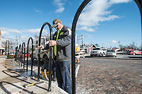 STAFF PHOTO ANTHONY REYES &bull; @NWATONYR<br /> Sean Dagestad, with the Rogers Street Department, sets a section of fence in place Monday, Dec. 15, 2014 along a sidewalk along south First Street in Rogers. Dagestad and a coworker were making sure all the pieces were plumb and level before permanently attaching the pieces. The fence will help people climb a tall curb and to keep them from falling down in accidentally.