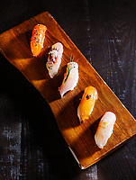 From left to right, nigiri dishes including Masu (Tasmanian Ocean Trout, Tobiuo (Flying Fish), Kinmedai (Golden eye Snapper), Inada (Baby Yellowtail) and Kurudai (Black Bream) at Uchi Restaurant in Denver, Colorado, Monday, March 25, 2019. <br /> <br /> Photo by Matt Nager