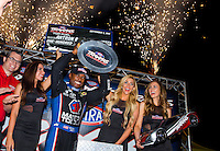 Sep 5, 2015; Clermont, IN, USA; NHRA top fuel driver Antron Brown celebrates after winning the 100,000 dollar prize in the Traxxas Shootout during qualifying for the US Nationals at Lucas Oil Raceway. Mandatory Credit: Mark J. Rebilas-USA TODAY Sports
