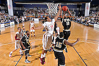 18 November 2010:  FIU's DeJuan Wright (10) takes a rebound away from FSU's Terrance Shannon (15) in the first half as the Florida State University Seminoles defeated the FIU Golden Panthers, 89-66, at the U.S. Century Bank Arena in Miami, Florida.