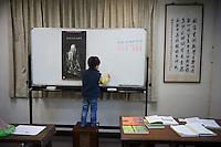 "A Taiwanese boy learns Chinese at Chien Mu's old home ""Sushulou"" in Waishuangxi of Shilin District, Taipei, Taiwan, 2015. Chien, who was considered to be one of the greatest historians and philosophers in 20th-century China, relocated to Taiwan in October 1967 after accepting an invitation from the then President Chiang Kai-shek in response to the Hong Kong 1967 Leftist Riots."