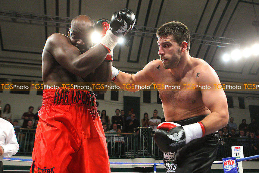 Sam Sexton (black shorts) defeats Larry Olubamiwo in a Heavyweight boxing contest at York Hall, Bethnal Green, promoted by Queensberry Promotions - 13/01/12 - MANDATORY CREDIT: Gavin Ellis/TGSPHOTO - Self billing applies where appropriate - 0845 094 6026 - contact@tgsphoto.co.uk - NO UNPAID USE.