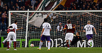Calcio, Europa League: Ritorno degli ottavi di finale Roma vs Fiorentina. Roma, stadio Olimpico, 19 marzo 2015.<br /> Fiorentina's Gonzalo Rodriguez, second from left, scores on a penalty kick during the Europa League round of 16 second leg football match between Roma and Fiorentina at Rome's Olympic stadium, 19 March 2015.<br /> UPDATE IMAGES PRESS/Riccardo De Luca