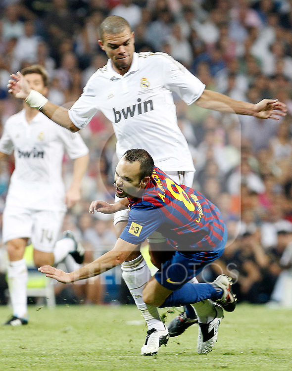 Real Madrid's Pepe (b) and FC Barcelona's Andres Iniesta during Spanish Supercup 1st match.August 14,2011. (ALTERPHOTOS/Acero)
