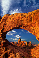 714000072 turret arch framed through north window arch an iconic scene in arches national park in utah