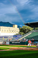 A rainbow glows over the park as the Idaho Falls Chukars  played the Ogden Raptors in Pioneer League action at Lindquist Field on August 26, 2015 in Ogden, Utah. Ogden defeated the Chukars 5-1. (Stephen Smith/Four Seam Images)