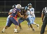 Lawndale, CA 10/14/16 - \n75\, Austin Thrush (North Torrance #57) and Musika Vailea (Leuzinger #55) in action during the North Torrance vs Leuzinger CIF League football game.