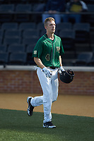 D.J. Poteet (4) of the Wake Forest Demon Deacons returns to the dugout after hitting a solo home run in the bottom of the first inning against the Louisville Cardinals at David F. Couch Ballpark on March 17, 2018 in  Winston-Salem, North Carolina.  The Cardinals defeated the Demon Deacons 11-6.  (Brian Westerholt/Four Seam Images)