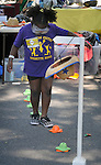A young girl participates in one of the youth activities of the 11th Annual Mid-town Make a Difference Day Celebration on Franklin Street, in Kingston, NY on Saturday, June  18, 2016. Photo by Jim Peppler. Copyright Jim Peppler 2016.