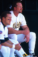 OAKLAND, CA - Mark McGwire of the Oakland Athletics waits in the dugout during a game against the Seattle Mariners at the Oakland Coliseum in Oakland, California in 1997. Photo by Brad Mangin