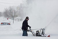 A man uses a snowblower to remove snow from a sidewalk in the Huron Village neighborhood in Cambridge, Massachusetts, USA, on Saturday, Feb. 9, 2013, after Winter Storm Nemo hit the area.