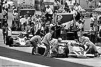 HAMPTON, GA - APRIL 22: The pit crew of Tom Sneva (#1 McLaren M24/Cosworth TC) begins work while George Bignotti and his crew push Gordon Johncock (#20 Penske PC6/Cosworth TC) out of the pit box and back into the race during the Gould Twin Dixie 125 event on April 22, 1979, at Atlanta International Raceway near Hampton, Georgia.