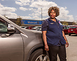 April 13, 2018. New Bern, North Carolina.<br /> <br /> Cat Davis, photographed outside the Walmart store where she works. <br /> <br /> Davis, a Walmart employee, helped lead a successful movement to get family leave for all Walmart employees.