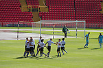 The home players celebrating Josh Gillies equalising goal at the Gateshead International Stadium, the athletics stadium which is also the home ground of Gateshead FC (in white), as the club play host to Cambridge United in a Blue Square Bet Premier division fixture. The match ended in a one-all draw, watched by a crowd of 904. The point meant Gateshead went to the top of the division, one below the Football League in England.
