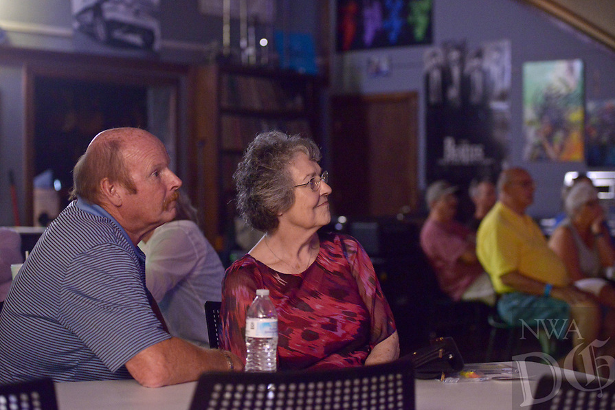 NWA Democrat-Gazette/BEN GOFF @NWABENGOFF<br /> Rusty Anderson, president of the Bentonville Alumni Association and a 1972 graduate of Bentonville High School, and Wylene Cohagan, also of Bentonville, listen to Rick Dodson (not pictured) play Saturday, July 15, 2017, during the Bentonville Alumni Association's 4th annual Sweet Jam Music Fest at Meteor Guitar Gallery in downtown Bentonville. The festival is a fundraiser that helps support scholarships the association gives each year to seniors in the Bentonville school district.