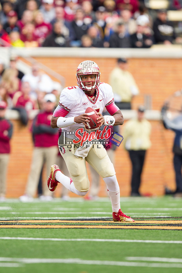 Florida State Seminoles quarterback Jameis Winston (5) rolls out to his left during second half action against the Wake Forest Demon Deacons at BB&T Field on November 9, 2013 in Winston-Salem, North Carolina.  The Seminoles defeated the Demon Deacons 59-3.    (Brian Westerholt/Sports On Film)