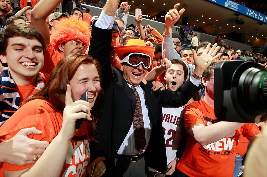Sportcaster Dick Vitale poses with Virginia fans before the start of an NCAA basketball game against Louisville Saturday Feb. 7, 2015, in Charlottesville, Va. (Photo/Andrew Shurtleff)