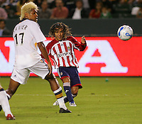 CD Chivas USA midfielder Francisco Mendoza (6) takes a shot on goal past LA Galaxy defender Abel Xavier (17) during the first half. CD Chivas USA defeated the LA Galaxy in the Super Clasico 3-0 at the Home Depot Center in Carson, CA, Thursday, September 13, 2007.