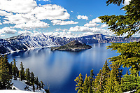View of Crater Lake during the early summer with snow still on the ground.