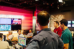 The morning following deadly tornados in Texas, meteorologists and producers discuss daily plans at the morning meeting inside of the newsroom at The Weather Channel in Atlanta, Georgia May 16, 2013.