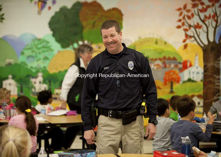 WOODBURY, CT-13 November 2013-111313BF06- School Resource Officer Craig Tibbals checks safety and visits with students and teachers daily at Mitchell Elementary School in Woodbury. Officer Craig, as he is known to students, started as the school resource officer at the school in September and is at the school each day students are present. Bob Falcetti Republican-American