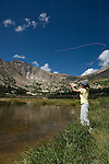 Woman fishing at Lawn Lake on a summer morning in Rocky Mountain National Park, Colorado, USA, model release #93