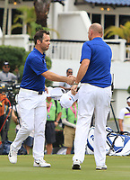 Paul Casey (Europe) and Thomas Bjorn (Captain Team Europe) on the 18th green during the Singles Matches of the Eurasia Cup at Glenmarie Golf and Country Club on the Sunday 14th January 2018.<br /> Picture:  Thos Caffrey / www.golffile.ie