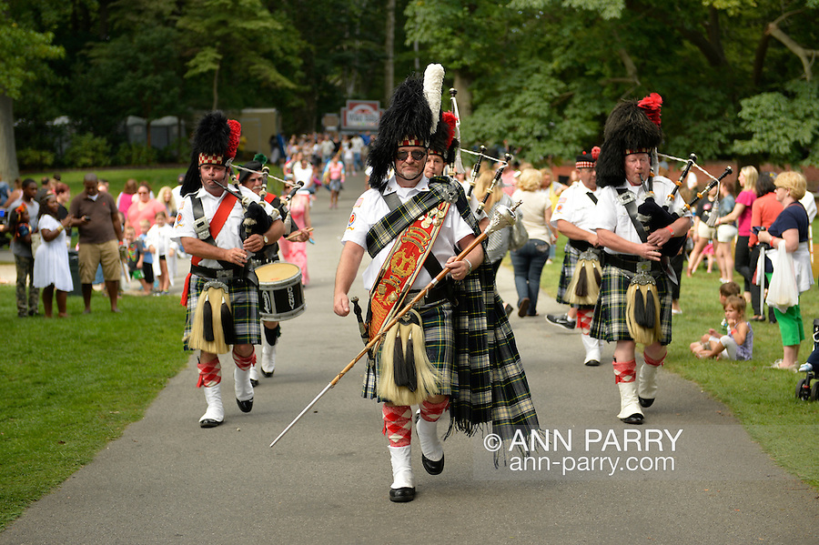 Old Westbury, New York, U.S. - August 23, 2014 - Clan Gordon Highlanders Pipe Band, of Locust Valley, are marching and playing bagpipe music at the 54th Annual Long Island Scottish Festival and Highland Games, co-hosted by L. I. Scottish Clan MacDuff, at Old Westbury Gardens.