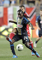 CHESTER, PA - AUGUST 12, 2012:  Keon Daniel (26) of the Philadelphia Union shields the ball from  Michael Videira (21) of the Chicago Fire during an MLS match at PPL Park, in Chester, PA on August 12. Fire won 3-1.