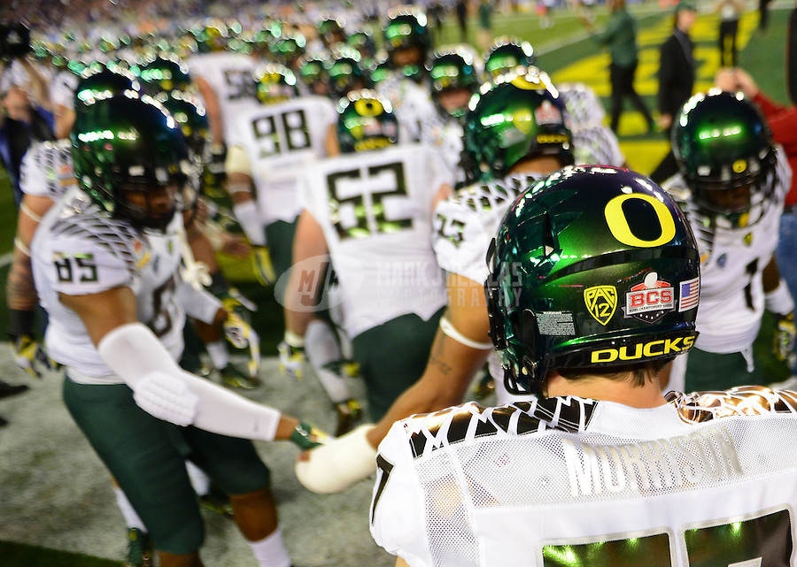 Jan. 3, 2013; Glendale, AZ, USA: Oregon Ducks players enter the field prior to the game against the Kansas State Wildcats during the 2013 Fiesta Bowl at University of Phoenix Stadium. Mandatory Credit: Mark J. Rebilas-