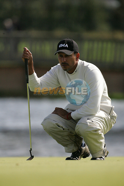 Jeev Milkha Singh lines up his putt on the par 3 17th hole during the first round of the Smurfit Kappa European Open at The K Club, Strffan,Co.Kildare, Ireland 5th July 2007 (Photo by Eoin Clarke/NEWSFILE)