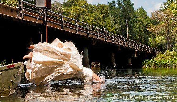 Amanda Nalley and husband John Stubbs enjoy the Wakulla River in their wedding attire August 26, 2011.