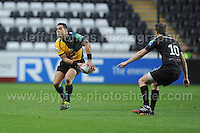 Former Ospreys scrum half Kahn Fotuali'i now with Northampton Saints about to throw a pass. Liberty Stadium, Swansea, South Wales 12.01.14. Ospreys v Northampton Heineken Cup round 5 pool 1 - pIc credit Jeff Thomas photography