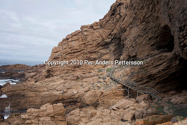 MOSSEL BAY, SOUTH AFRICA - MAY 26: A view of the sea and rocks from outside a cave called PP13B on May 26, 2010, at Pinnacle Point near Mossel Bay South Africa. The cave sheltered humans between 164,000 and 35,000 years ago, at a time when Homo sapiens was in danger of dying out. These people may have been the ancestors of us. (Photo by Per-Anders Pettersson/Getty Images)