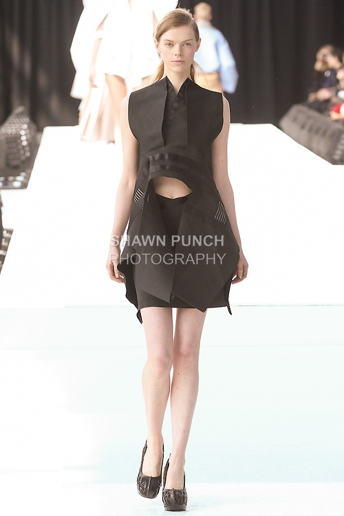 Model walks runway in an outfit by graduating fashion student Ho Yi Du (Joy), during the Parsons 2015 fashion show at the Jacob Javits Center, on May 19, 2015.