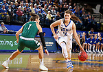 SIOUX FALLS, SD - NOVEMBER 29: Macy Miller #12 from South Dakota State looks to drive past Jen Wellnitz #1 from Wisconsin Green Bay during their game Thursday night at Frost Arena in Brookings. (Photo by Dave Eggen/Inertia)