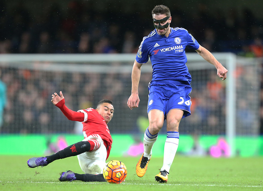 Chelsea's Nemanja Matic is tackled by Manchester United's Jesse Lingard<br /> Photographer Kieran Galvin/CameraSport<br /> <br /> Football - Barclays Premiership - Chelsea v Manchester United - Sunday 7th February 2016 - Stamford Bridge - London<br /> <br /> &copy; CameraSport - 43 Linden Ave. Countesthorpe. Leicester. England. LE8 5PG - Tel: +44 (0) 116 277 4147 - admin@camerasport.com - www.camerasport.com