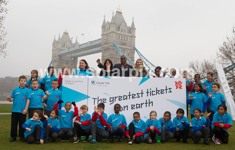 **ALL ROUND PICTURES FROM SOLARPIX.COM**                                             **NO UK NEWSPAPER PUBLICATION**.**UK MAGAZINE & SUPPLEMENT PUBLICATION ONLY** AND NO PUBLICATION IN AUSTRALIA, BELGIUM, FRANCE, GERMANY, ITALY, SCANDINAVIA AND USA**                                                                                  Caption: Legendary Olympians Nadia Comaneci, Carl Lewis and Rebecca Adlington joined Seb Coe and Boris Johnson at a photocall in London this morning to  mark exactly 500 days to go until the Opening Ceremony of London 2012 and the day that the application process opens for tickets to the Olympic Games                                                                              .This pic:  Nadia Comaneci,Carl Lewis and Rebecca Adlington Olympic Photocall                                                                                            JOB REF: 12974       SFE       DATE:  15.03.2011                                                          **MUST CREDIT SOLARPIX.COM OR DOUBLE FEE WILL BE CHARGED**                                                                      **MUST AGREE FEE BEFORE ONLINE USAGE**                               **CALL US ON: +34 952 811 768 or LOW RATE FROM UK 0844 617 7637**