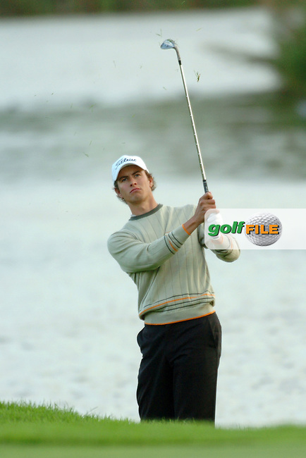THOMASTOWN, IRELAND. Adam Scott playing his 3rd shot onto the 18th Green during the American Express Championship day two at the Mount Juliet Golf Club on October 1th, 2004 in Thomastown, Ireland ..Photo AFP/NEWSFILE/EOIN CLARKE..(Photo credit should read Eoin Clarke/NEWSFILE/AFP)...This Picture has been sent you under the condtions enclosed by:.Newsfile Ltd..the Studio,.Millmount Abbey,.Drogheda,.Co Meath..Ireland..Tel: +353(0)41-9871240.Fax: +353(0)41-9871260.GSM: +353(0)86-2500958.email: pictures@newsfile.ie.www.newsfile.ie.FTP: 193.120.102.198..This picture is from Fran Caffrey@newsfile.ie