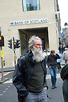 Bearded man and Bank of Scotland, Edinburgh. Photo copyright Graham Harrison.