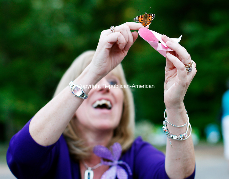 """Torrington, CT- 03, June 2011-060311CM11 Elaine Harrison, of Torrington, releases a butterfly at The Center for Cancer Care in Torrington, Conn. Friday afternoon. Harrison attended the third annual """"Butterfly Affair"""", a fundraiser to help cancer patients in the area.  Butterflies were released into the air and is recognized as a symbol of hope.  More then 500 people attended this annual event, more then last year said Elaine Tedesco, of Southbury and the Community Coordinator of Valerie Manner, which was one of the sponsors for the event.  Christopher Massa Republican-American"""