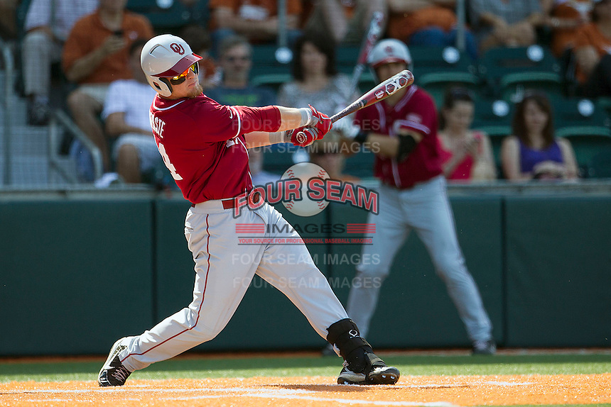 Oklahoma Sooners designated hitter Matt Oberste #14 swings the bat against the Texas Longhorns in the NCAA baseball game on April 6, 2013 at UFCU DischFalk Field in Austin, Texas. The Longhorns defeated the rival Sooners 1-0. (Andrew Woolley/Four Seam Images).