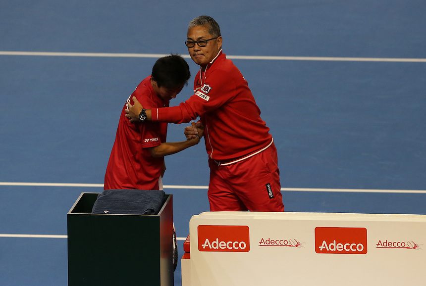 Japan Team Captain Captain Minoru Ueda consoles Yoshihito Nishioka after he and partner Yasutaka Uchiyama lose their doubles rubber against Andy Murray and Jamie Murray today - Andy Murray and Jamie Murray (GBR) def Yoshihito Nishioka and Yasutaka Uchiyama (JPN) 6-3 6-2 6-4<br /> <br /> Photographer Stephen White/CameraSport<br /> <br /> International Tennis - 2016 Davis Cup by BNP Paribas - World Group First Round - Great Britain v Japan - Day 2 - Saturday 5th March 2016 - Barclaycard Arena, Birmingham, Great Britain<br /> <br /> &copy; CameraSport - 43 Linden Ave. Countesthorpe. Leicester. England. LE8 5PG - Tel: +44 (0) 116 277 4147 - admin@camerasport.com - www.camerasport.com.