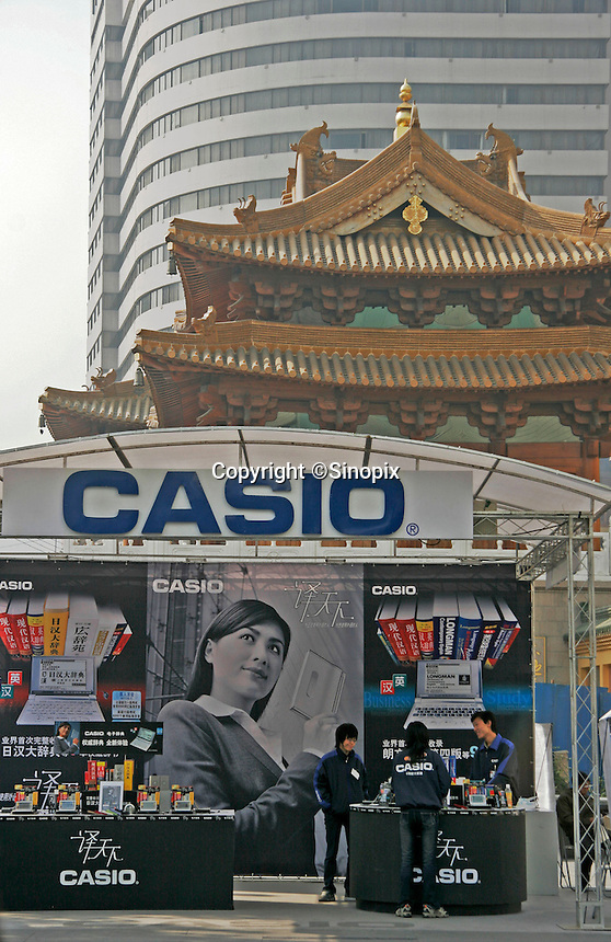 An electronics booth sells Casio products in front of the Jin'an Buddhist temple in Shanghai, China..