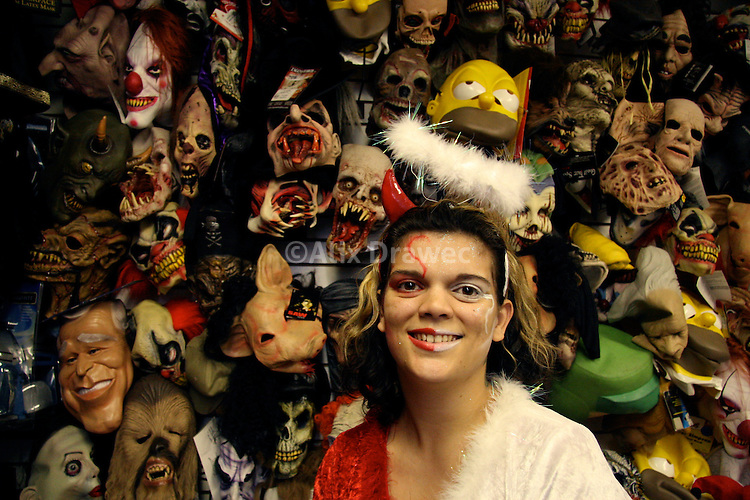 aahs staff member grace mojica helps customers find halloween costumes at the west hollywood store