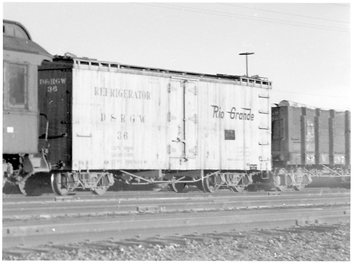 3/4 view of D&amp;RGW short reefer in train at Alamosa.<br /> D&amp;RGW  Alamosa, CO  Taken by Richardson, Robert W. - 12/3/1948