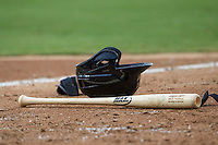 Baseball bat and helmet on the ground during the Pacific Coast League baseball game between the Sacramento River Cats and the Round Rock Express on June 19, 2014 at the Dell Diamond in Round Rock, Texas. The Express defeated the River Cats 7-1. (Andrew Woolley/Four Seam Images)