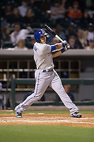 Mikie Mahtook (7) of the Durham Bulls follows through on his swing against the Charlotte Knights at BB&T BallPark on April 14, 2016 in Charlotte, North Carolina.  The Bulls defeated the Knights 2-0.  (Brian Westerholt/Four Seam Images)