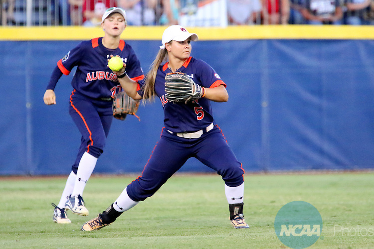 06 JUNE 2016: Emily Carosone (5) of Auburn University fields the ball against University  of Oklahoma during the Division I Women's Softball Championship held at ASA Hall of Fame Stadium in Oklahoma City, OK.  University of Oklahoma defeated Auburn University in Game 1 by the final score of 3-2. Shane Bevel/NCAA Photos