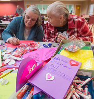 NWA Democrat-Gazette/BEN GOFF @NWABENGOFF<br /> Bertha Akins (left) of Rogers and Jolene Farris of Rogers help make Valentine's Day cards Thursday, Feb. 7, 2019, at the Benton County Senior Activity and Wellness Center in Bentonville. Meals on Wheels of Benton County operates out of the center, delivering hot meals to 127 home-bound seniors in Benton County five days a week. The group was making the cards to be delivered with meals on Valentines Day.